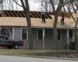 Men Working on a Roof